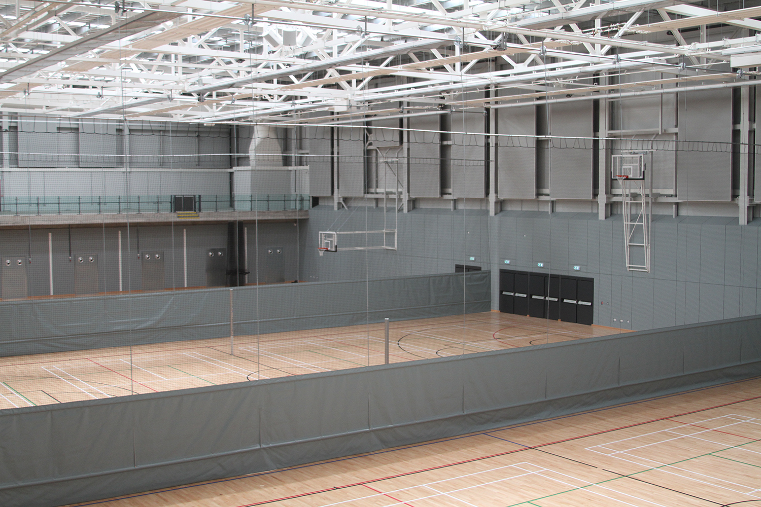 Emirates Arena Basketball Goals & Motorised Dividers by Unisport