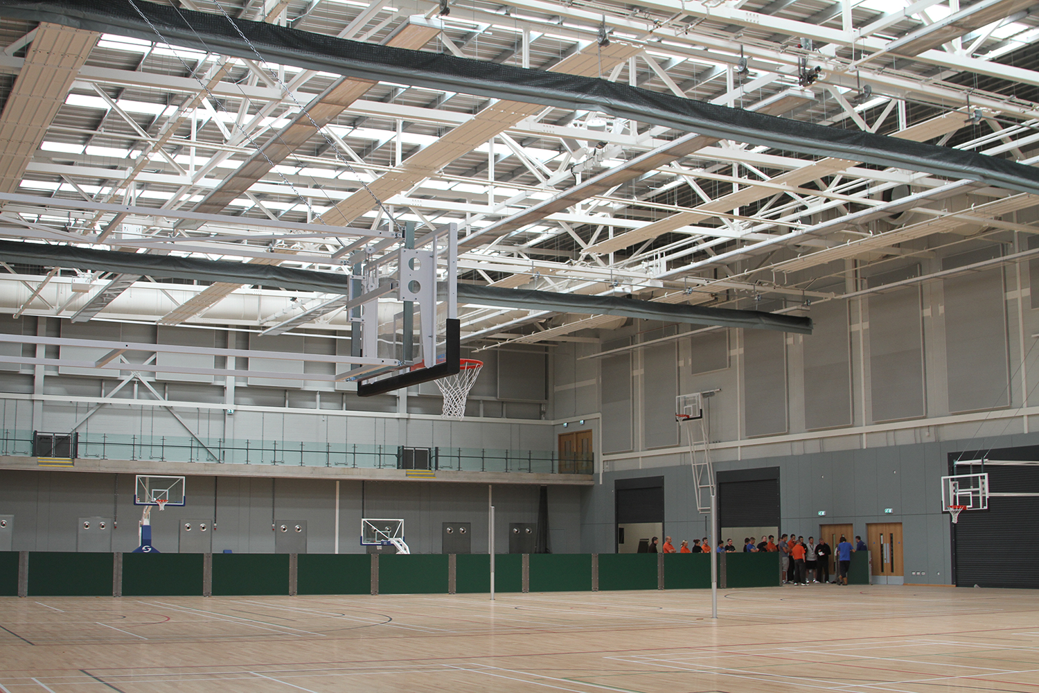 Emirates Arena Sports Hall Basketball Goals & Motorised Dividers by Unisport
